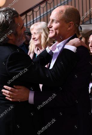 Joaquin Phoenix and Woody Harrelson