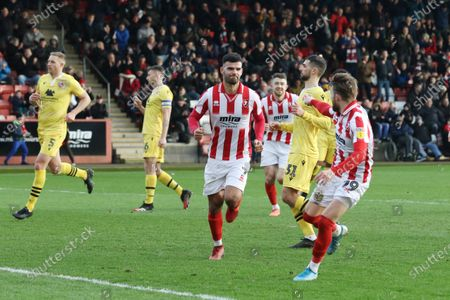 Stock Picture of d Conor Thomas scores the penalty and runs of to celebrateuring the EFL Sky Bet League 2 match between Cheltenham Town and Morecambe at Jonny Rocks Stadium, Cheltenham