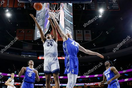 Jeremiah Robinson-Earl, Kelvin Jones. Villanova's Jeremiah Robinson-Earl (24) and Kelvin Jones (43) leap for a rebound during the second half of an NCAA college basketball game, in Philadelphia