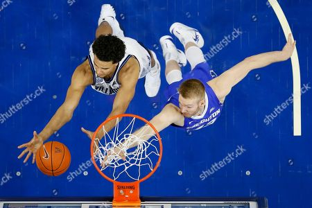 Jeremiah Robinson-Earl, Kelvin Jones. Villanova's Jeremiah Robinson-Earl, left, and Creighton's Kelvin Jones leap for a rebound during the second half of an NCAA college basketball game, in Philadelphia