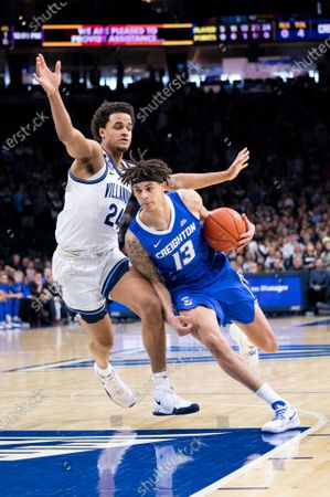 Stock Image of Creighton Bluejays forward Christian Bishop (13) drives to the basket against Villanova Wildcats forward Jeremiah Robinson-Earl (24) during the NCAA basketball game between the Creighton Bluejays and the Villanova Wildcats at the Wells Fargo Center in Philadelphia, Pennsylvania