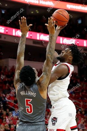 North Carolina State's DJ Funderburk (0) shoots over Louisville's Malik Williams (5) during the first half of an NCAA college basketball game in Raleigh, N.C