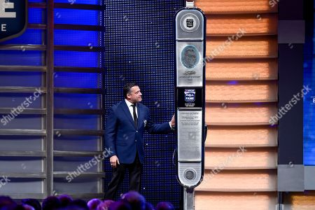 Tony Stewart looks at his inductee spire during the NASCAR Hall of Fame induction ceremony in Charlotte, N.C