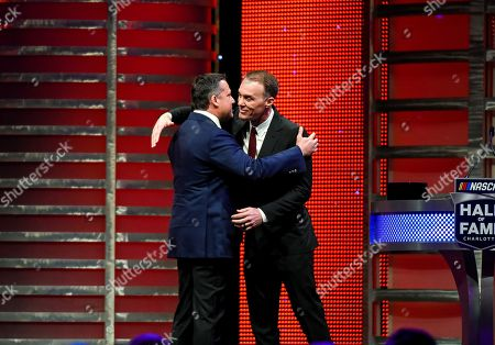 Kevin Harvick induces NASCAR Hall of Fame inductee Tony Stewart during the induction ceremony in Charlotte, N.C