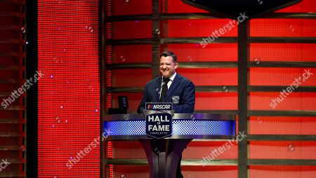 Stock Image of NASCAR Hall of Fame inductee Tony Stewart talks about his career in racing during the induction ceremony in Charlotte, N.C
