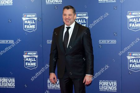 NASCAR Hall of Fame inductee Tony Stewart poses for pictures prior to the induction ceremony in Charlotte, N.C