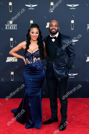 Ashley Brown, Adrian Peterson. Ashley Brown and Adrian Peterson arrive at the 9th Annual NFL Honors at the Adrienne Arsht Center in Miami on