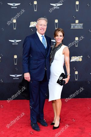 Paige Green, John Elway. From left, John Elway and wife, Paige Green, arrive at the 9th Annual NFL Honors at the Adrienne Arsht Center in Miami on