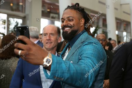 Cameron Jordan, right, attends the 9th Annual NFL Honors at the Adrienne Arsht Center, in Miami