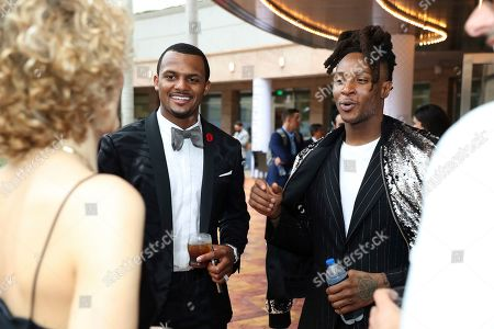 Deshaun Watson, left, and DeAndre Hopkins, both of the Houston Texans, attend the 9th Annual NFL Honors at the Adrienne Arsht Center, in Miami