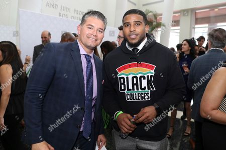 Omar Ruiz, left, Bobby Wagner, of the Seattle Seahawks, attend the 9th Annual NFL Honors at the Adrienne Arsht Center, in Miami