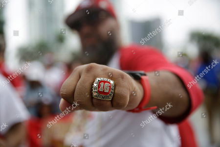 Stock Photo of San Francisco 49ers fan Alberto Pedraza wears a former San Francisco 49ers football player Joe Montana Hall of Fame ring in support for the team, in Miami, for the NFL Super Bowl 54 football game