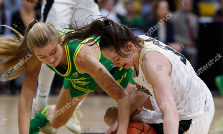 Stock Picture of R m. Oregon forward Lydia Giomi, left, fights for control of a loose ball with Colorado guard Emma Clarke in the first half of an NCAA college basketball game, in Boulder, Colo
