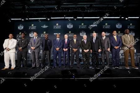 Hall of Fame Class of 2020, from left, Troy Polamalu, Edgerrin James, Steve Hutchinson, Isaac Bruce, Steve Atwater, Paul Tagliabue, Donnie Shell, Jimmie Johnson, Cliff Harris, Bill Cowher, Jimbo Covert, and Harold Carmichael pose at the NFL Honors football award show, in Miami