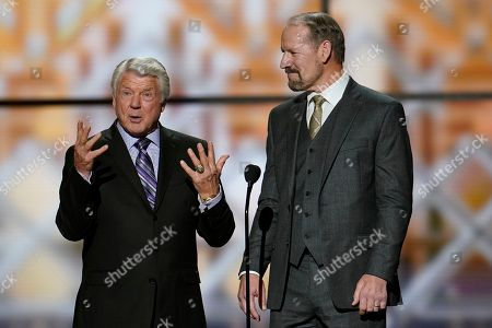 Former coaches, Jimmie Johnson, left, and Bill Cowher making introductions at the NFL Honors football award show, in Miami