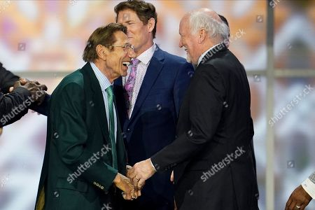 Former NFL player Joe Namath, left, speaks to former Dallas Cowboys safety Cliff Harris at the NFL Honors football award show, in Miami