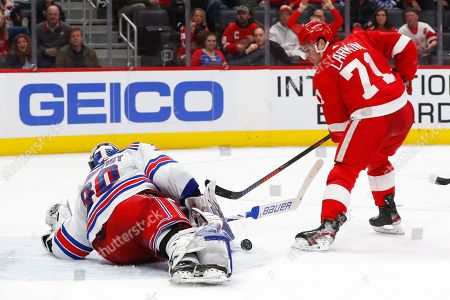 New York Rangers goaltender Henrik Lundqvist (30) stops a Detroit Red Wings center Dylan Larkin (71) shot in the second period of an NHL hockey game, in Detroit