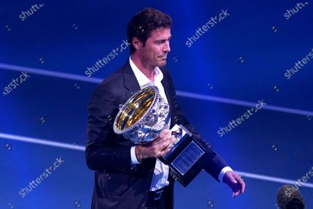 Stock Image of Former Russian tennis player Marat Safin carries the Norman Brookes Challenge Cup ahead of the men's singles final between Dominic Thiem of Austria and Novak Djokovic of Serbia at the Australian Open Grand Slam tennis tournament at Rod Laver Arena in Melbourne, Australia, 02 February 2020.