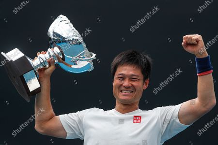 Shingo Kunieda of Japan celebrates with a trophy after winning his Men's Wheelchair Singles final match against Gordon Reid of Britain at the Australian Open Grand Slam tennis tournament in Melbourne, Australia, 02 February 2020.