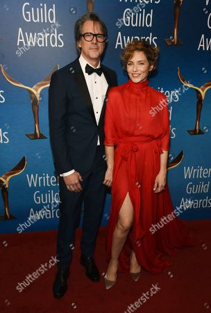 "Charles Randolph, Mili Avital. Screenwriter Charles Randolph, left, recipient of the Paul Selvin Award for his script for the film ""Bombshell,"" poses with his wife Mili Avital at the 2020 Writers Guild Awards at the Beverly Hilton, in Beverly Hills, Calif"