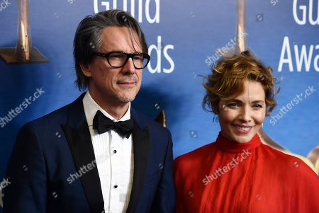 Charles Rudolph, Mili Avital. Screenwriter Charles Rudolph and his wife, actress Mili Avital, pose together at the 2020 Writers Guild Awards at the Beverly Hilton, in Beverly Hills, Calif