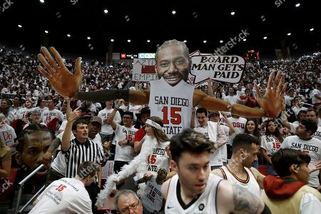 San Diego State fans hold up an image of former San Diego State forward Kawhi Leonard, now with the Los Angeles Clippers, before an NCAA college basketball game against Utah State, in San Diego