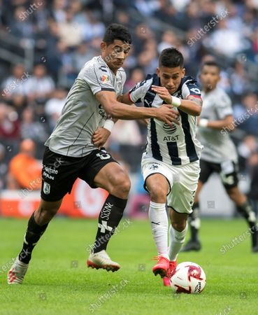 Monterrey's midfielder Maximiliano Meza (R) in action against Queretaro's defender Jorge Aguilar (L) during a day four match of the Mexican Clausura 2020 tournament at the BBVA Stadium in Monterrey, Mexico, 01 February 2020.