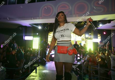 Remy Ma performs at the Pepsi Super Splash Pool Party at Pepsi Neon Beach, in South Beach, FL