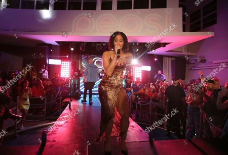 Stock Image of Angelica Vila performs at the Pepsi Super Splash Pool Party at Pepsi Neon Beach, in South Beach, FL