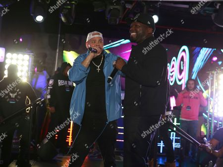Stock Image of 50 Cent, Fat Joe. Rappers 50 Cent and Fat Joe perform at the Pepsi Super Splash Pool Party at Pepsi Neon Beach, in South Beach, FL