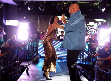 Stock Photo of Angelica Vila, Fat Joe. Singer Angelica Vila and rapper Fat Joe perform at the Pepsi Super Splash Pool Party at Pepsi Neon Beach, in South Beach, FL