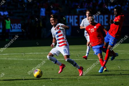 United States forward Ulysses Llanez (19) drives the ball past Costa Rica midfielder David Guzman (20) and defender Keysher Fuller (4) during an international friendly soccer match between United States and Costa Rica in Carson, Calif., . The U.S. won 1-0