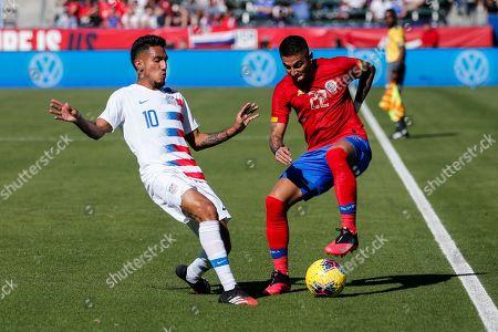 United States forward Jesus Ferreira (10) vies against Costa Rica midfielder David Guzman (20) during an international friendly soccer match between United States and Costa Rica in Carson, Calif., . The U.S. won 1-0