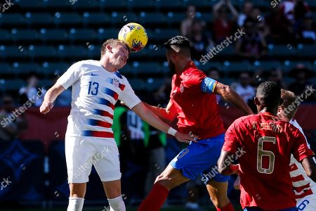 United States defender Sam Vines (13) heads the ball against Costa Rica defender Giancarlo Gonzalez (3) during an international friendly soccer match between United States and Costa Rica in Carson, Calif., . The U.S. won 1-0