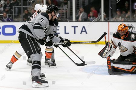 Anaheim Ducks goaltender Ryan Miller, right, stops a shot by Los Angeles Kings center Adrian Kempe, left, during the second period of an NHL hockey game in Los Angeles