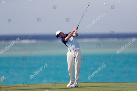 Stock Image of Ross Fisher from England tees off on the 17th hole during the final round of the Saudi International at Royal Greens Golf and Country Club, in Red Sea resort of King Abdullah Economic City, Saudi Arabia