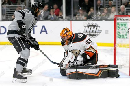 Los Angeles Kings left wing Alex Iafallo (19) looks for the puck to engage Anaheim Ducks goaltender Ryan Miller (30) during the second period of an NHL hockey game in Los Angeles