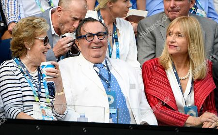 Australian actor Barry Humphries, center, prepares to watch the men's singles final between Serbia's Novak Djokovic and Austria's Dominic Thiem on Rod Laver Arena at the Australian Open tennis championship in Melbourne, Australia