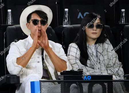 Bruneian actor, singer, and model, Wu Chun and his wife Lin Liying, right, watch the men's singles final between Serbia's Novak Djokovic and Austria's Dominic Thiem at the Australian Open tennis championship in Melbourne, Australia