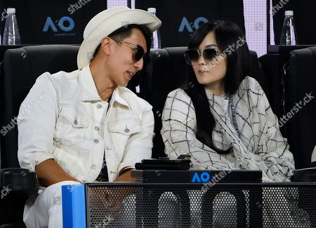 Bruneian actor, singer, and mode Wu Chun and his wife Lin Liying, right, watch the men's singles final between Serbia's Novak Djokovic and Austria's Dominic Thiem at the Australian Open tennis championship in Melbourne, Australia