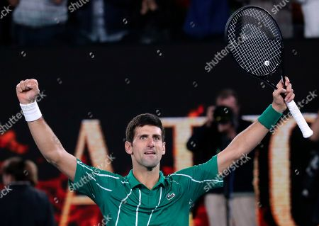 Serbia's Novak Djokovic celebrates after defeating Austria's Dominic Thiem in the men's singles final of the Australian Open tennis championship in Melbourne, Australia