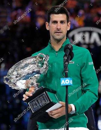 Serbia's Novak Djokovic holds the Norman Brooks Challenge Cup as he addresses the crowd after defeating Austria's Dominic Thiem in the men's singles final of the Australian Open tennis championship in Melbourne, Australia