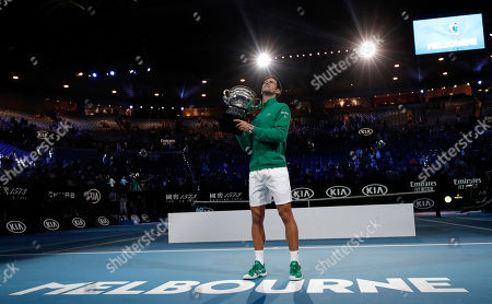 Serbia's Novak Djokovic holds the Norman Brookes Challenge Cup after defeating Austria's Dominic Thiem in the men's singles final of the Australian Open tennis championship in Melbourne, Australia