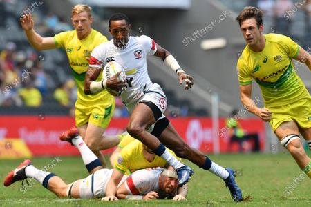 Perry Baker of the USA (C) finds a break against Australia on day two of the Sydney 7's Rugby Tournament at Bankwest Stadium in Sydney, New South Wales, Australia, 02 February 2020.