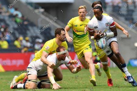 Ben Pinkelman of the USA (L, bottom) off loads the ball to teammate Perry Baker (R) in action against Australia on day two of the Sydney 7's Rugby Tournament at Bankwest Stadium in Sydney, New South Wales, Australia, 02 February 2020.