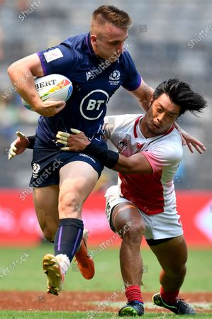 Ross McCann (L) of Scotland is tackled by Ryota Kano of Japan on day two of the Sydney 7's Rugby Tournament at Bankwest Stadium in Sydney, New South Wales, Australia, 02 February 2020.