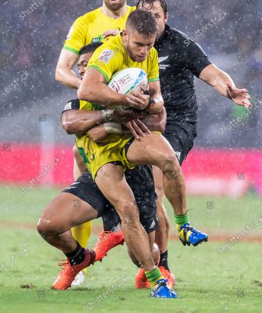 Josh Turner of Australia is tackled during the men's 5th place playoff against New Zealand on day two of the Sydney 7's Rugby Tournament at Bankwest Stadium in Sydney, New South Wales, Australia, 02 February 2020.