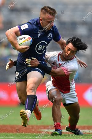 Ross McCann of Scotland (L) is tackled by Ryota Kano of Japan on day two of the Sydney 7's Rugby Tournament at Bankwest Stadium in Sydney, New South Wales, Australia, 02 February 2020.