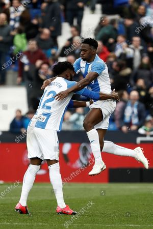 Leganes' Nigerian defender Kenneth Omeruo (R) celebrates with teammate Chidozie Awaziem (L) after scoring during the Primera Division LaLiga match held between Leganes and Real Sociedad at Butarque stadium in Leganes, Madrid, Spain, 02 February 2020.
