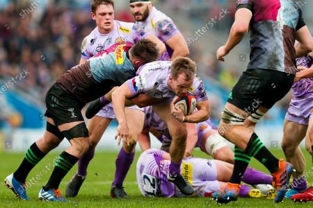 Stuart Townsend of Exeter Chiefs is tackled by Will Evans of Harlequins